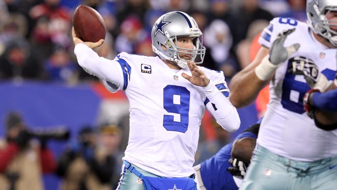 Dallas Cowboys quarterback Tony Romo (9) drops back to pass against the New York Giants during the second quarter of a game at MetLife Stadium.