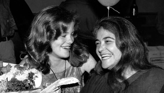 Feminist activist Kate Millett, right, at a surprise birthday party for her niece, Kristan Vigard in 1979, has died at 82.