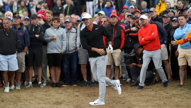 Brooks Koepka of the United States plays out of the rough on the 15th hole during the first round of the British Open Golf Championship, at Royal Birkdale, Southport, England Thursday, July 20, 2017. Koepka, the reigning U.S. Open champion, is tied for the first-round lead with fellow Americans, Jordan Spieth and Matt Kuchar,  at 5-under par. (AP Photo/Peter Morrison)