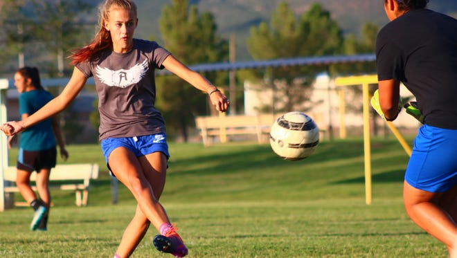 Alamogordo junior Sheyenne Drake takes a shot at the goal Wednesday evening during practice at the Riner Steinoff Soccerplex.