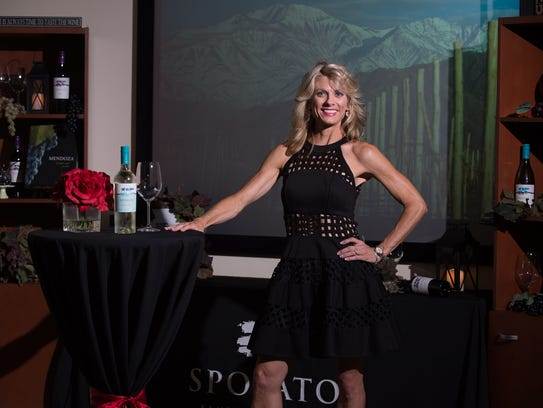 Karen Sposato wears a black Alexis dress from Neiman