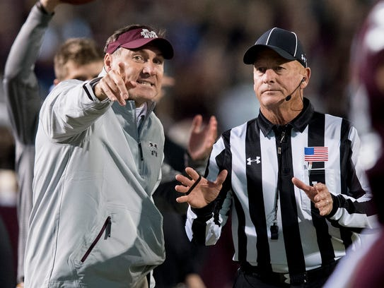 Mississippi State head coach Dan Mullen works the umpires