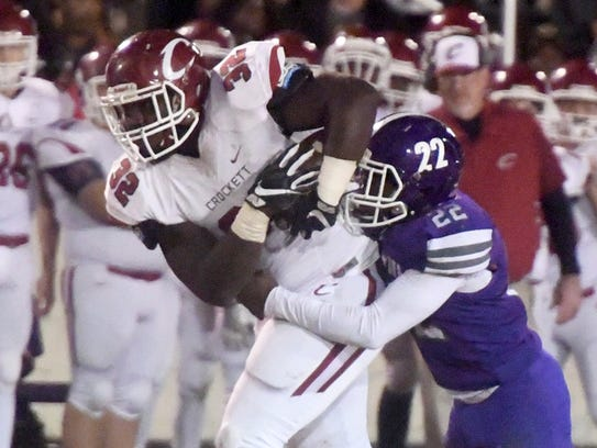 Crockett County's Jordan Branch is grabbed from behind