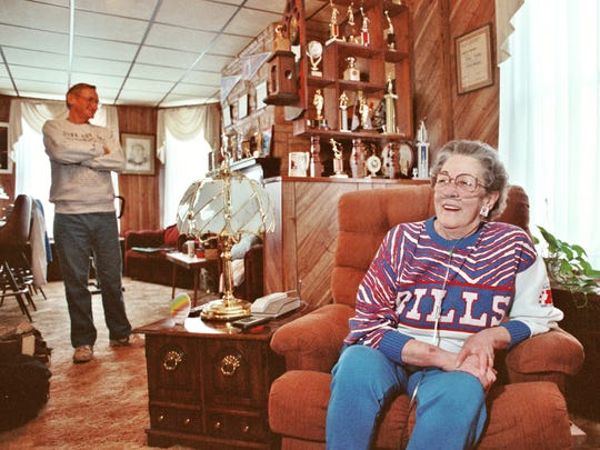 Joe and Alice Kelly relax at home amid their son's trophies on Jan. 24, 1992.