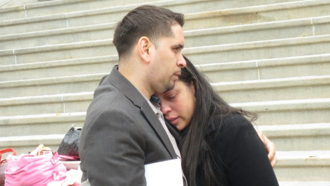 Andre Rodriquez consoles his girlfriend, Alexandria Bodden, whose brother was a victim of gun violence