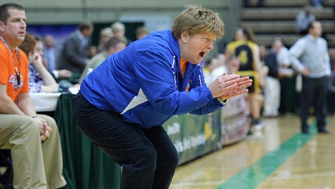 Livonia girls basketball coach Karen Schuster urging on players in the fourth quarter of the Class B semifinal of the 2016 girls basketball state tournament.