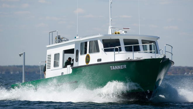 The research vessel Tanner dedicated in honor of former Fisheries Chief and former DNR Director Howard Tanner.