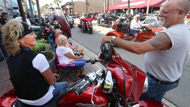 Biketoberfest visitors watch a parade of people and motorcycles on Main Street at last year's Biketoberfest in Daytona Beach.