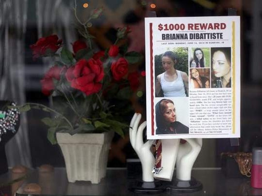 A missing person flyer is posted in a window in Dunkirk, Indiana, where Brianna DiBattiste grew up.