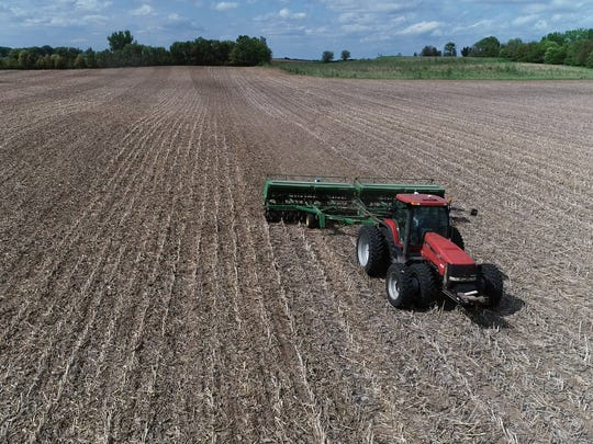 A farmer plants soybeans in a field near Perry on May 22, 2018.