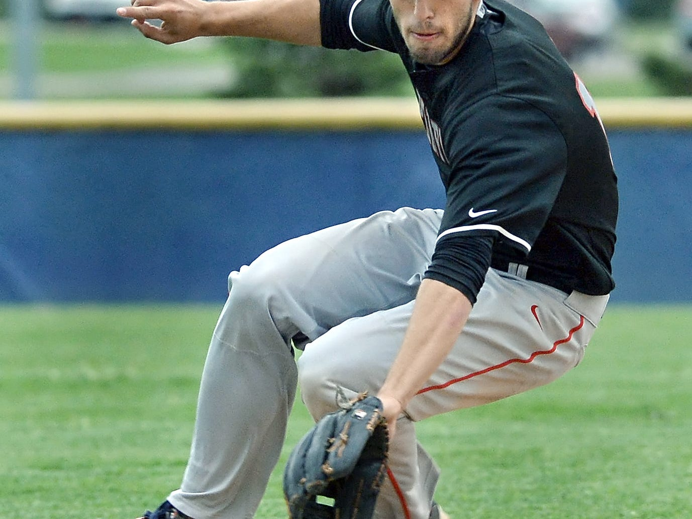 Penfield shortstop Colin Spencer knocks down a ground ball during a first-round game of the Class AA Sectionals played at Victor High School on Tuesday. No. 9 seed Penfield eliminated No. 8 seed Victor 5-4.