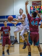 Piedra Vista's Christian Chavez shoots around Shiprock's