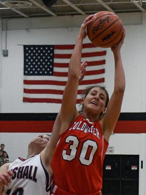 Coldwater's Carlee Crabtree (30) recovers a rebound against Marshall on Dec. 8, 2017.