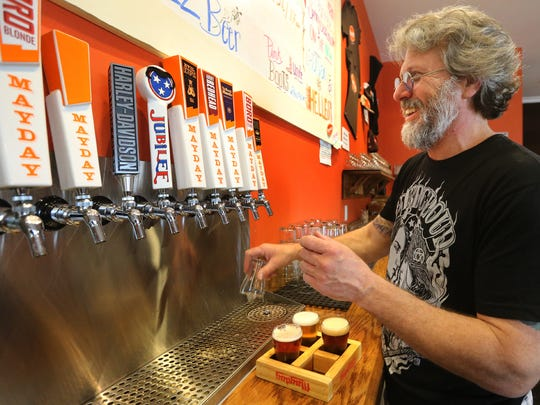 Ozzy Nelson, the owner of Mayday Brewery fills a sampler of the 4 main beers Boro Blonde, Velvet Hustle, Angry Redhead and Evil Octopus, at Mayday on Saturday April 25, 2015.