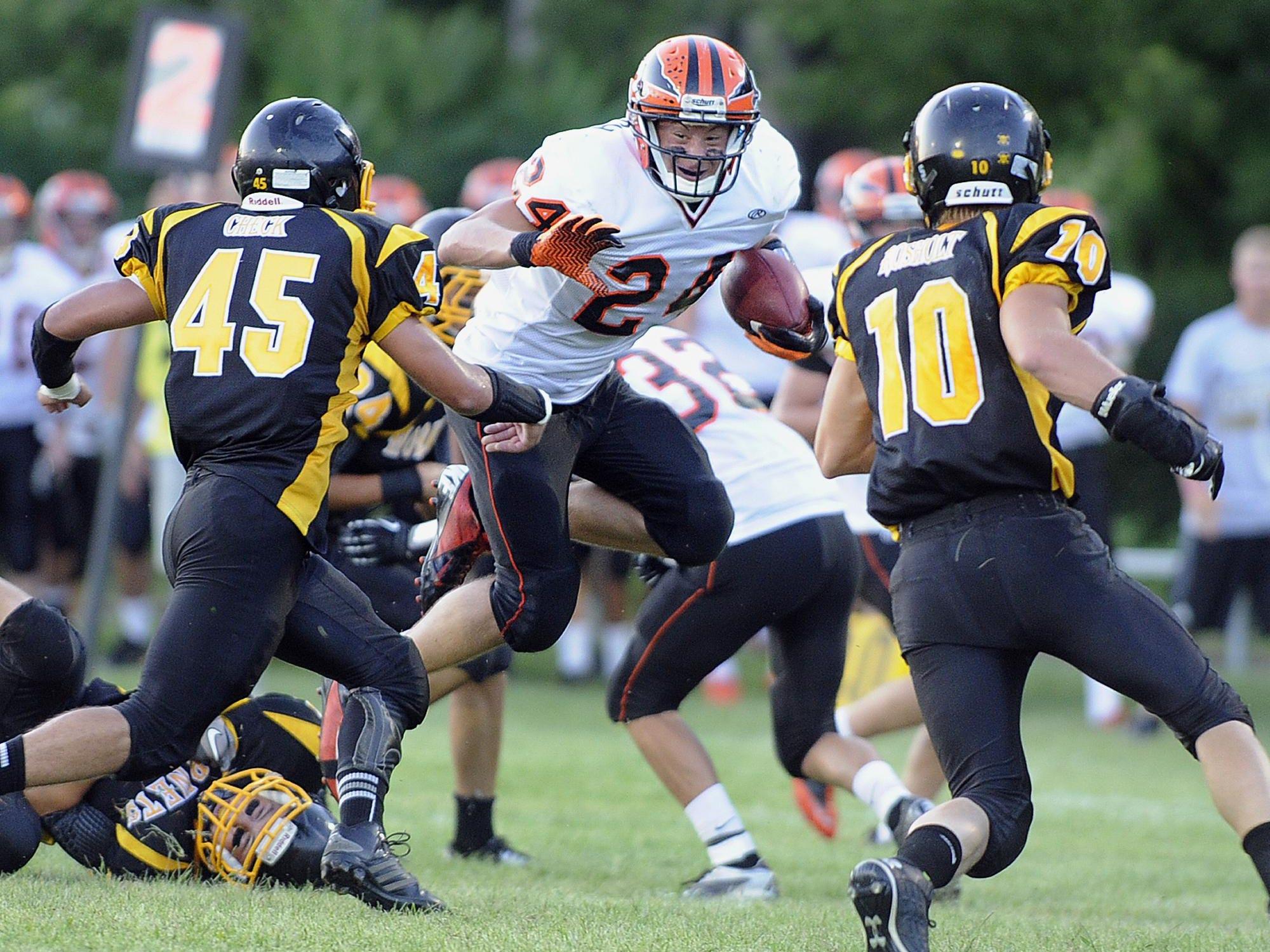 Iola-Scandinavia's Kristian Welch, center, will play football at the University of Iowa.