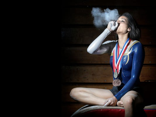MARK LAMBIEÑEL PASO TIMES Eastwood gymnast Dianelliz Tirado brought home gold in the vault and bronze on the uneven bars.
