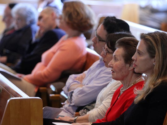 Anna Balaban, a Holocaust survivor, and her daughter Nona Balaban, right, sit with members of Congregation B'nai Israel and listen to a Holocaust Remembrance.