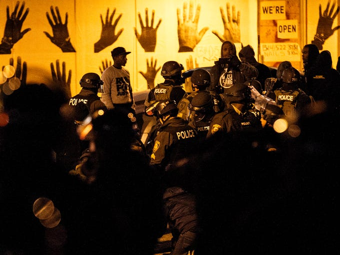 Ferguson Police arrest protesters after the grand jury