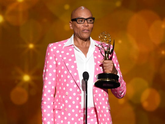 "RuPaul Charles accepts the Emmy Award for Outstanding Host for a Reality or Reality-Competition Program in September for ""RuPaul's Drag Race."""