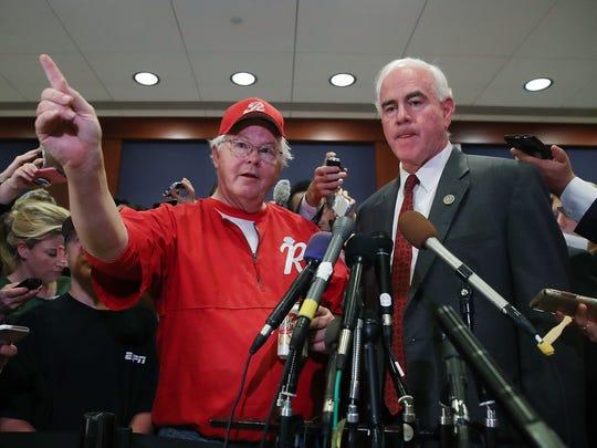 Reps. Joe Barton and Patrick Meehan speak to the media
