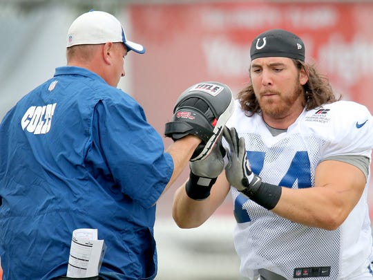 Anthony Castonzo works with offensive line coach Joe Gilbert,left, during Indianapolis Colts training camp Tuesday afternoon at Anderson University. MATT KRYGER /  THE STAR