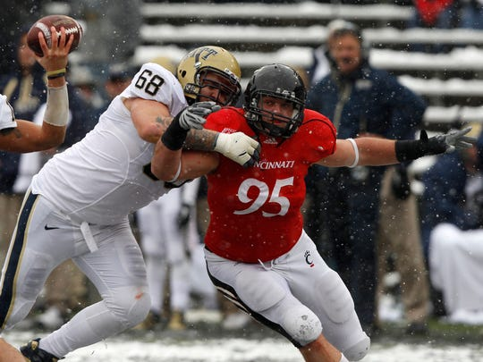 Derek Wolfe rushes the passer in 2010 for the Bearcats. He'll start for the Broncos in Sunday's Super Bowl.