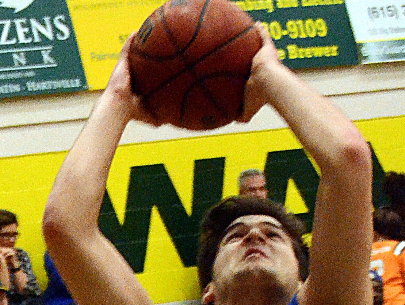 White House High freshman center Cameron Baldwin elevates for a first-quarter shot. Baldwin scored three points.