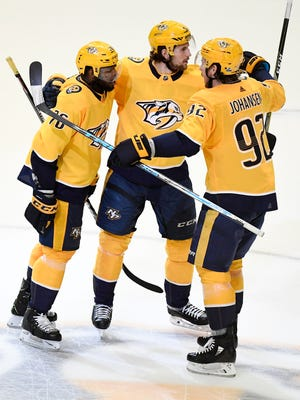 Nashville Predators defenseman P.K. Subban (76) celebrates his goal with left wing Filip Forsberg (9) and center Ryan Johansen (92) during the first period of Game 7 of the second round NHL Stanley Cup Playoffs at Bridgestone Arena, Thursday, May 10, 2018, in Nashville, Tenn.