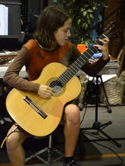 Gigi Kirton, 15, shows her prowess on classical guitar. The Christian Home Educators Association of Collier County held their annual Extracurricular Expo on Monday at Center Point Community Church.