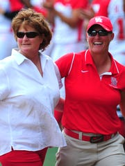 Yvette Girouard (left), who led both Louisiana at Lafayette and LSU to the Women's College World Series, is pictured with former Ragin' Cajun softball player Kyla Holas during a game in Lafayette in 2013. Girouard is one of eight inductees in the 2015 Louisiana Sports Hall of Fame Induction Class.