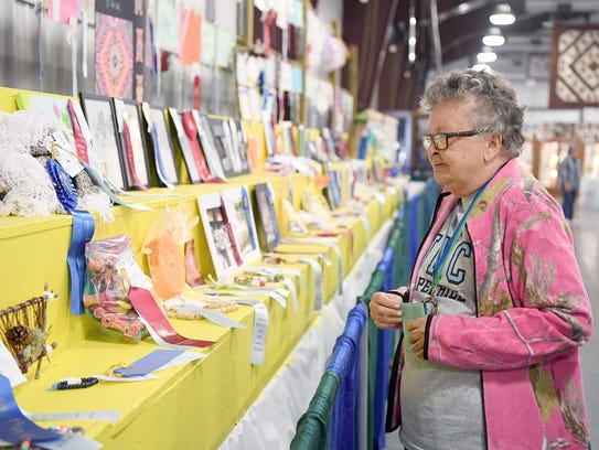 Linda Johnson checks the rows of Very Special Arts