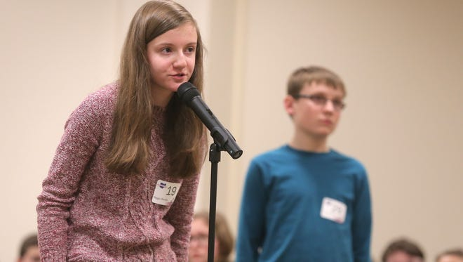 Maggie Sheridan competes at the Tri County Spelling Bee on Thursday. The Lexington middle schooler won the Bee, this time being her third year in a row.