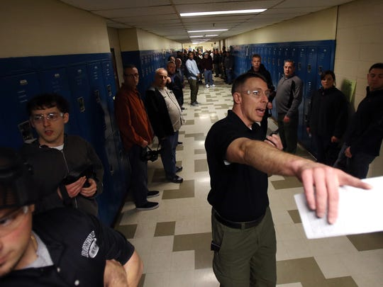 ALICE instructor, Detective Derek Jones of the Georgetown (MA) Police Department organizes Roxbury police officers, along with about 80 other law enforcement and school officials go through traditional lockdown scenario during ALICE training, preparing for a school shooter  throughout the halls of Roxbury High School. March 29, 2016. Roxbury, N.J.