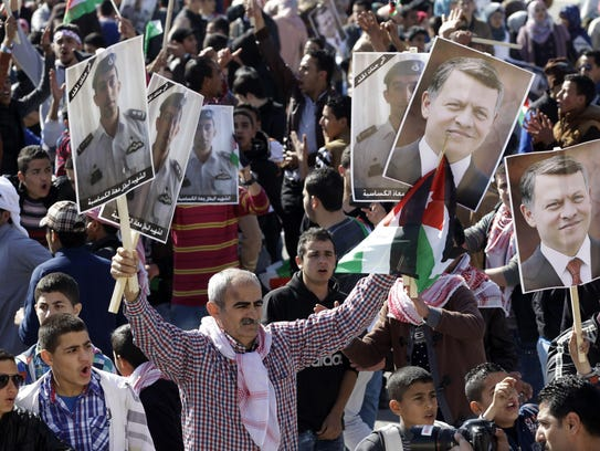 Jordanians chant slogans to show their support for
