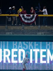 Alabama outfielder Keith Holcombe (18) watches as a