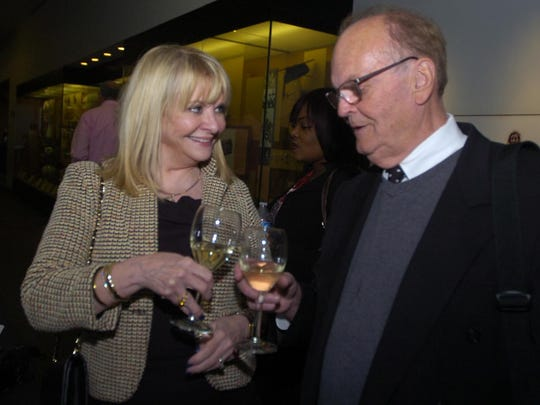 Susan Kehoe and Michael Haggerty from Bloomfield Hills delightfully, toast with Michigan Grape & Wine white wine.