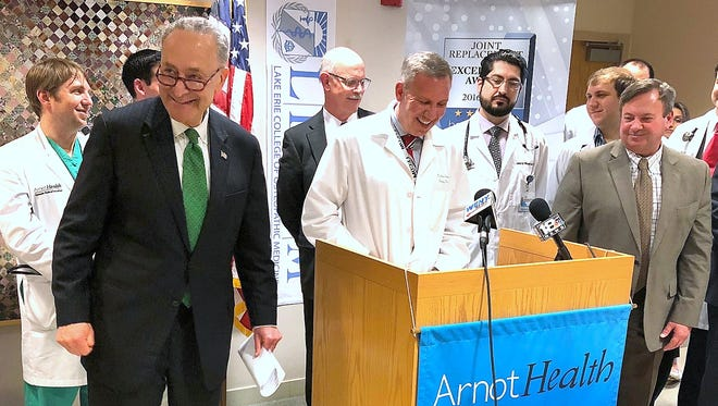 U.S. Sen. Charles Schumer, left, joins healthcare professionals and local officials Tuesday at Arnot Ogden Medical Center to announce a push for congressional action on a bill to address a looming doctor shortage.