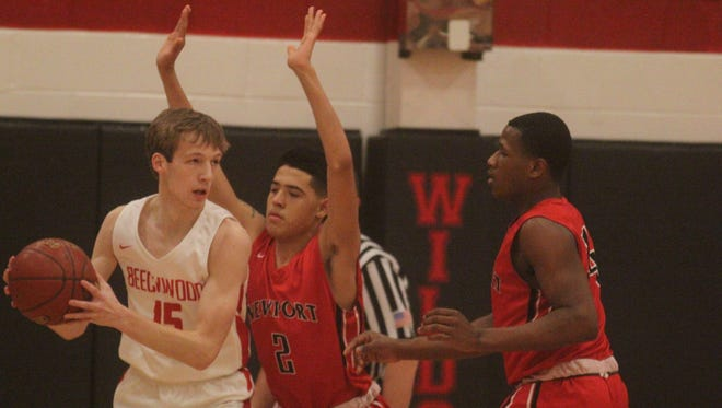 """Beechwood senior Ben Toebbe is pressured by Newport sophomore DaeShawn White, 2, during Beechwood's 54-53 boys basketball win over Newport in the All """"A"""" Classic 9th Region boys championship game Jan. 20, 2018."""
