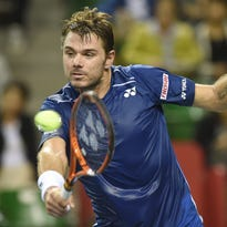 Stan Wawrinka hits a return against Benoit Paire during