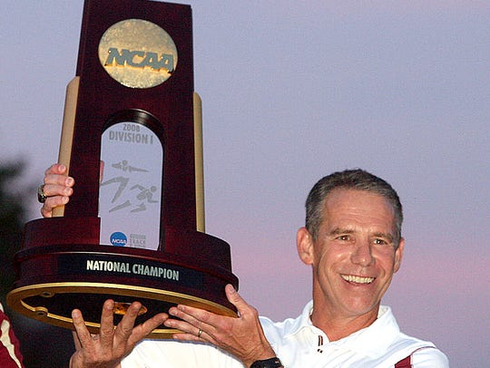 Florida State Athletic Director Randy Spetman hands