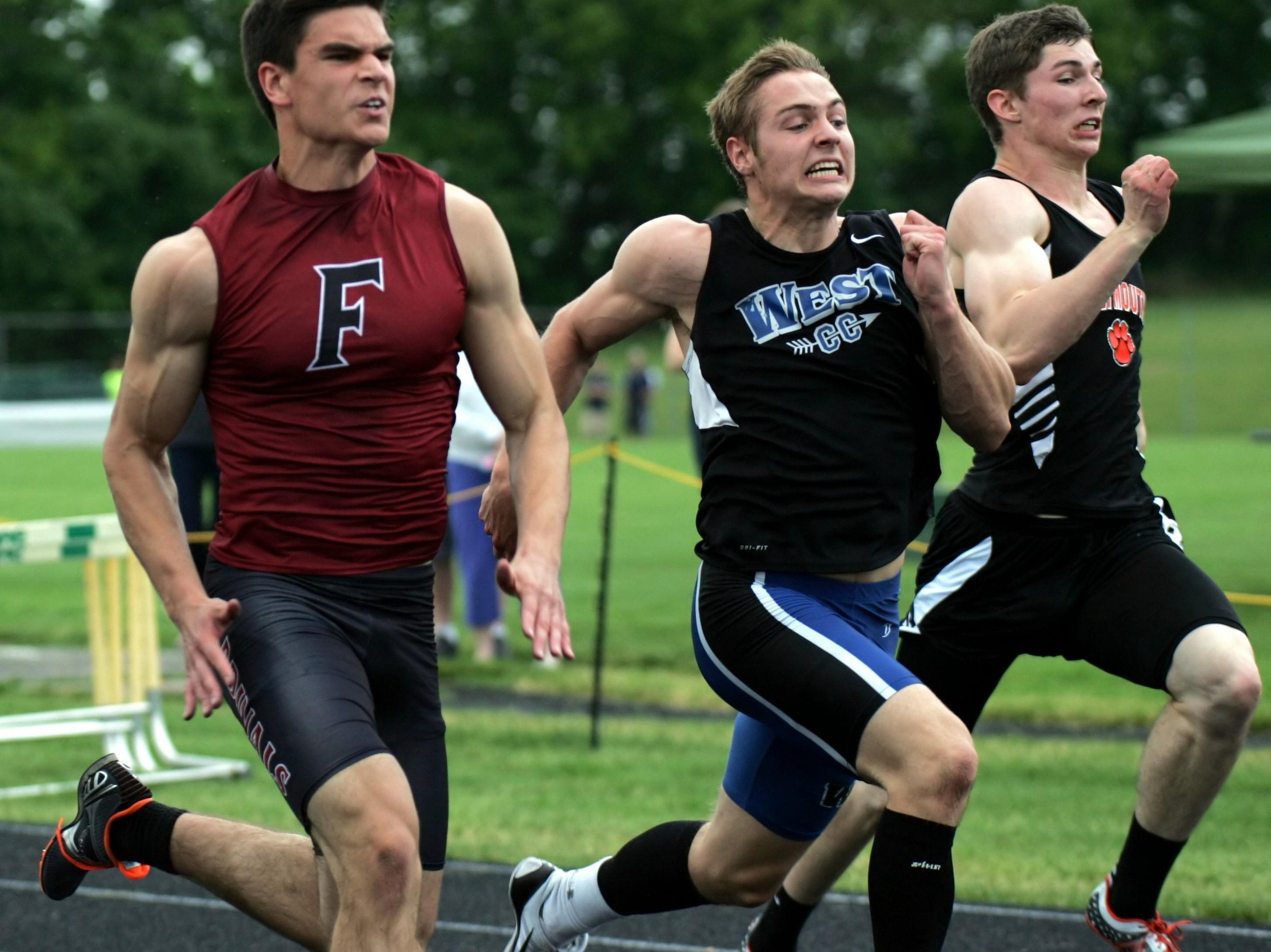 Fond du Lac's Nick Park (left) competes in the 100-meter dash in last Friday's Division 1 sectional track and field meet at Beaver Dam.