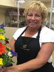 Sally Stutsman, the owner of Goshen Floral and Gift Shop, opposes same-sex marriage and says she doesn't know what she would do if a same-sex couple wanted to buy wedding flowers from her.