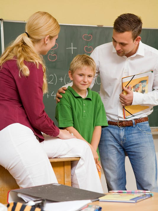 Teacher talking to parent and student