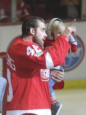 Red Wings captain Henrik Zetterberg and his son Love Zetterberg watch a video honoring Zetterberg before his 1000th career game Sunday, April 9, 2017 at Joe Louis Arena vs. the Devils in the final Wings game at the Joe before the team moves into Little Caesars Arena.