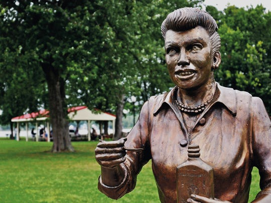 "In this Aug. 2012 photo, a bronze sculpture of Lucille Ball is displayed in Lucille Ball Memorial Park in the village of Celoron. A new statue of Ball was unveiled Saturday in the late actress' hometown to replace this one, which was so hated it was dubbed ""Scary Lucy."""