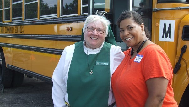 Sister Magdalena Kimberly, who runs a soup kitchen at St. Christine Christian Services in Detroit, with Tia Marie Sanders, the local organizer of the June 15 Feed the Children food-distribution event in Novi.