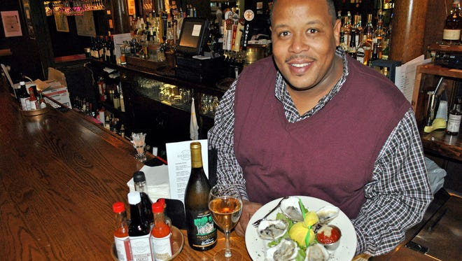 In a 2014 photo, Jai-Lee Dearing at his new restaurant, Rockefellers Oyster Bar and Grill in Grosse Pointe Park. A fire Sunday destroyed the building that housed the restaurant, police said. Photo credit: Mike Mannis.