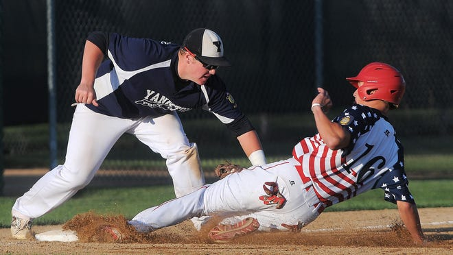 "Yankton Post 12's Mason Townsend (34) tags out Rapid City Post 22's Hayden McGriff (16) as he attempts to steal third base during the 2015 South Dakota American Legion Class ""A"" State Tournament championship game on Sunday, Aug. 2, 2015, at Bob Shelden Field in Brookings, S.D. Rapid City defeated Yankton 7 to 6 in extra innings."