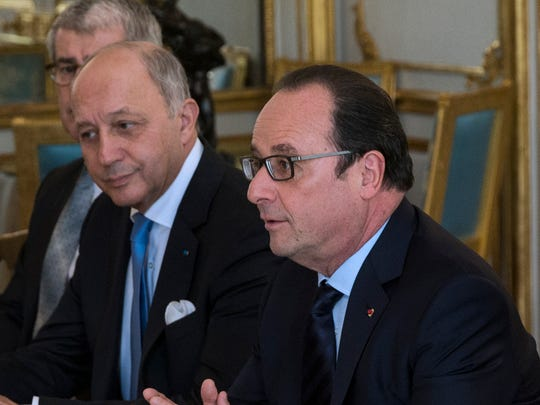 French President Francois Hollande, center, his Foreign Affairs Minister Laurent Fabius, left, and Ecology Minister Segolene Royal meet with representatives of NGOs specialized in environmental issue at the Elysee Palace in Paris, Saturday, Nov. 28, 2015.