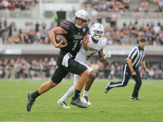 Mississippi State's Nick Fitzgerald (7) heads to the
